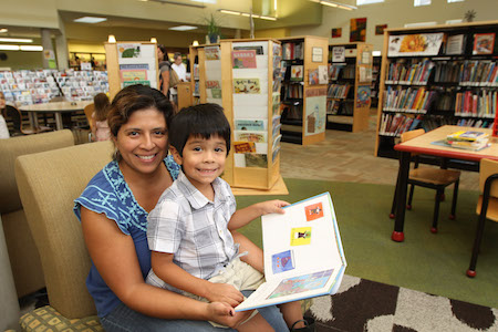 image of a mum and child reading in a library